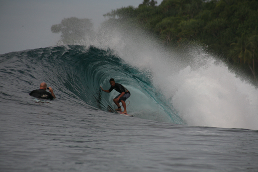 Man Surfing About Apola